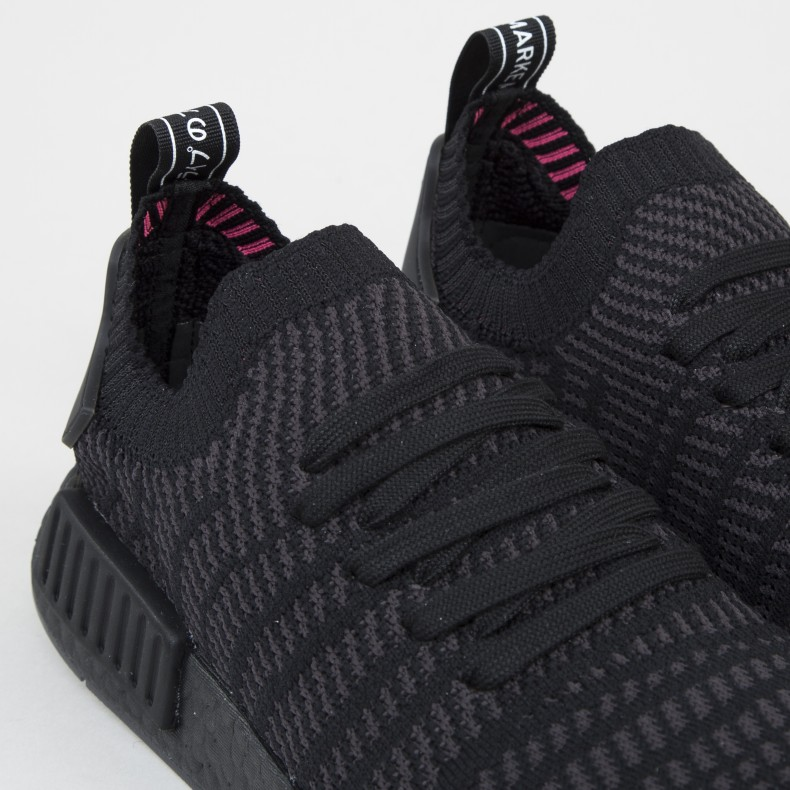 baaf610a1 adidas Originals NMD R1 STLT Primeknit  Triple Black . (Core Black Utility  Black Solar Pink)
